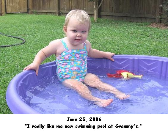[Just lounging around in my new swimming pool at Grammy and Grandaddy's house.]