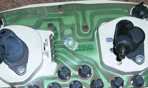 [The circuit board after I pulled off the rubber bumper and scraped off most of the JB Weld.]