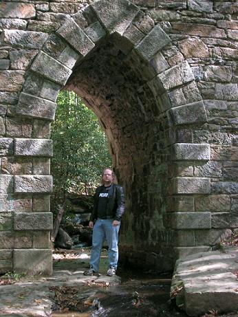 [Here I am standing inside the archway of Poinsett Bridge.]