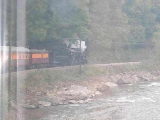 [Here you can see the locomotive through the window of our rail car, as we round a bend.]