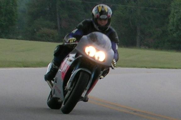 [Another shot of me riding the GSXR on the perimeter road behind the subdivision.]